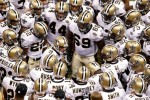 Quarterback Drew Brees (9) of the New Orleans Saints leads his team in a chant as they huddle up prior to playing against the Minnesota Vikings at Louisiana Superdome on September 9, 2010 in New Orleans, Louisiana. The Saints won 14-9 Chris Graythen/Getty Images .....